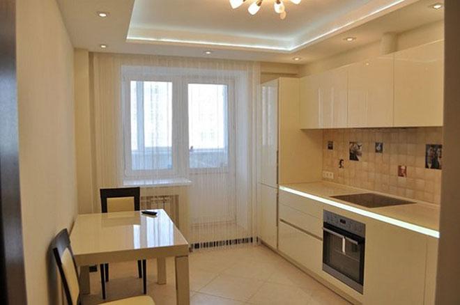 Бежевый двухуровневый натяжной потолок на кухне